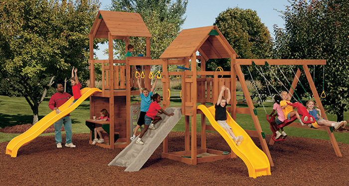 children using a wooden playset
